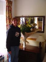 Merideth and her flowers that were waiting for her in our room in Skibbereen. It is our 15th anniversary this day.